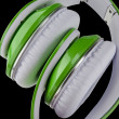 Green headphones isolated on a black background — Stock Photo