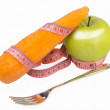 Measuring tape wrapped around a green apple and carrot — Stock Photo