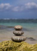 Believe hope love written on stones — Stock Photo
