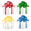 Set of colorful gift boxes with bows and ribbons. — Stock Vector #34728215