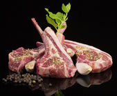 Raw lamb chops with spices and herbs — Stock Photo