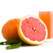 Grapefruit, and fruit juice in a glass on a white background — Stock Photo