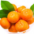 Wet tangerines in a glass bowl — Stock Photo