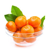 Tangerines in a glass bowl — Stock Photo