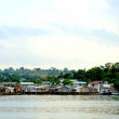 Stock Photo: Slums villages over seat Batam, Indonesia