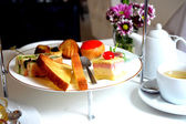 Afternoon tea pastries and cakes — Stock Photo