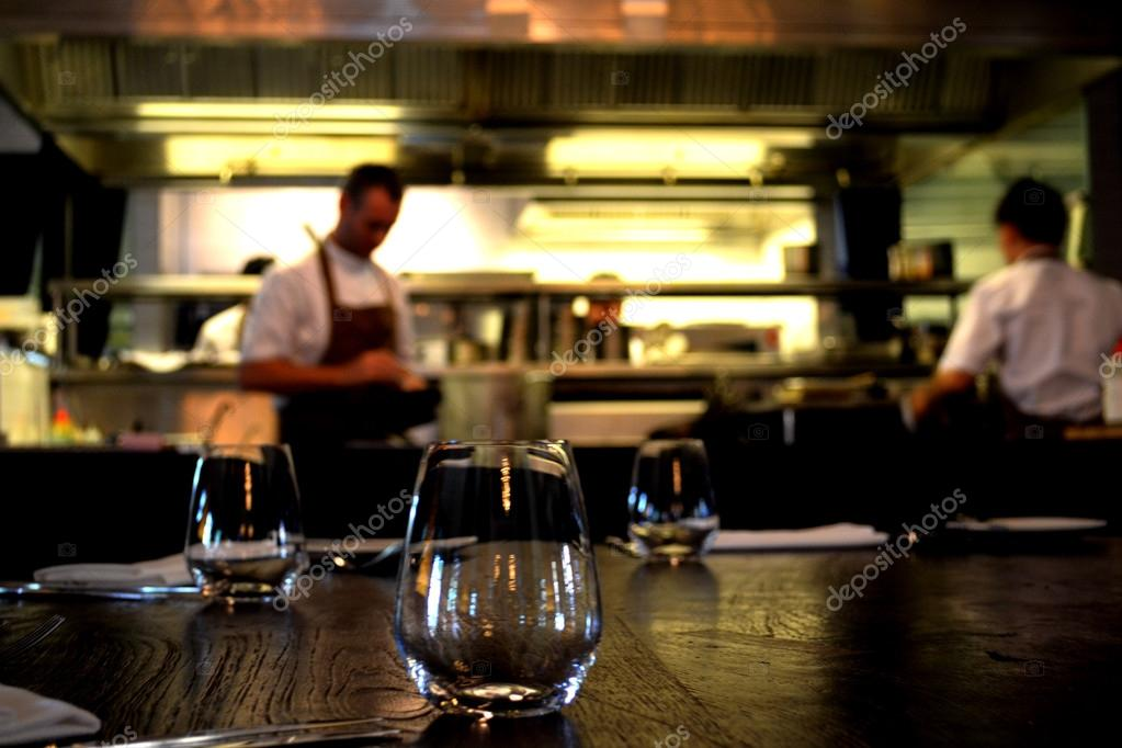 chef in open kitchen in casual dining restaurant — stock photo