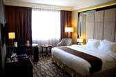 Beautiful luxury bedroom in condominium or hotel — Stock Photo