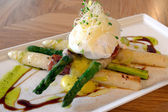 Grilled Asparagus & Wrapped in Prosciutto, with poached egg, black truffle vinaigrette & red shiso — Stock Photo
