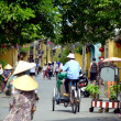 Trishaw driver at UNESCO heritage site in Hoi An, Vietnam — Stock Photo #40692585