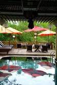 Swimming pool and deck chairs in hotel in Hoi An Vietnam — Stock Photo