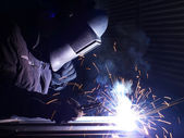 Welding and bright sparks. Hard job — Fotografia Stock