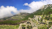 Rocks and hills on background sky. Panoramic composition — Stock Photo