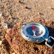 Stock Photo: Compass lying on stone