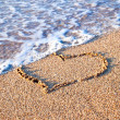 Heart drawn on sand - Foto de Stock