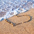 Heart drawn on sand - Stockfoto