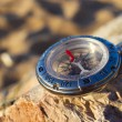 Stock Photo: Compass on stone.
