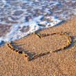 Heart on the sand — Stock Photo #23750321