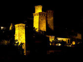 Towers at night time in old city. — Stock Photo