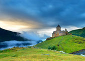 Old castle on peak of the mountain — Stock Photo