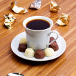 Cup with coffee and sweetmeat. — Stock Photo
