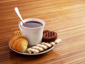 Cup of coffee with goodies — Stock Photo