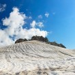 Mountain array. Snow and bright sky — Stock Photo