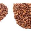 Heart and cup from coffee grains — Stock Photo