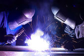 Welders team on factory — Stock Photo