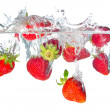 Bright strawberry and water splash. — Stock Photo
