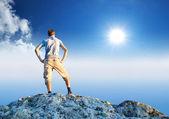 Person on the peak of mountain — Stock Photo