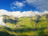 Meadow and rock on the sky background — 图库照片