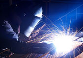 Welder and bright sparks — Stock Photo