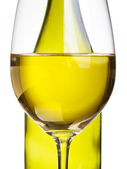 Wineglasses and bottle with white wine — Stock Photo