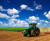 Tractor on field — Stock Photo
