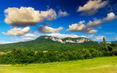 Green hills and sky — Foto Stock