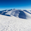 Snowy hills and sky — Stock Photo #41276773