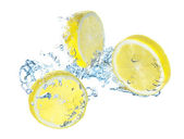 Parts of lemon and water splash — Stock Photo