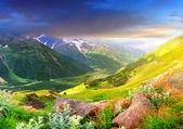 Sundown in large mountain valley — Stock Photo