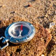 Stock Photo: Compass on beach