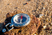 Compass on the beach — Stock Photo