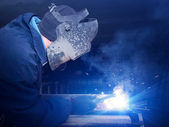 Welder on the industrial workplace — Stock Photo