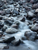 Fast river among dark stones — Stock Photo