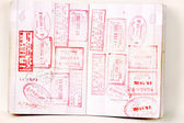 Hongkong and China stamps in passport — Stock Photo