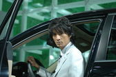 Chinese men model from car show — Stock Photo