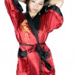 Pretty asian in dressing gown - Stock Photo