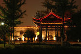 Chinese pavillion in park by night — Stock Photo