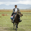 Horse rider in Shangrila - Stock Photo