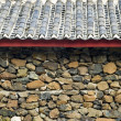 Stock Photo: Stoned wall and roof