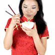 Chinese girl eating rice — Stock Photo